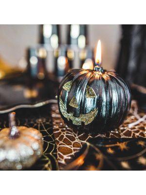 Iso musta halloween kurpitsa kynttilä kulta-glitterillä.