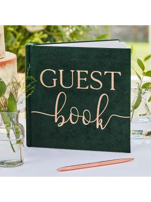 """Tummanvihreä sammettinen vieraskirja ruusukultaisella tekstillä """"Guest Book""""."""