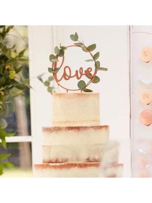 """Ruusukultainen kakkukoriste """"love""""."""