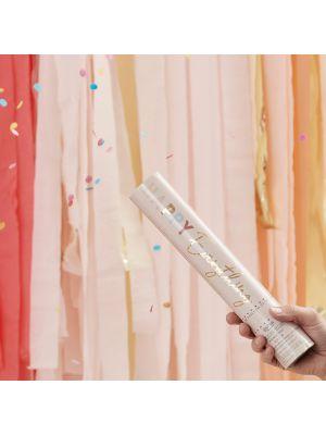 Kraft-konfettitykki joka ampuu ilmanpaineella valkoisia pyöreitä konfetteja.