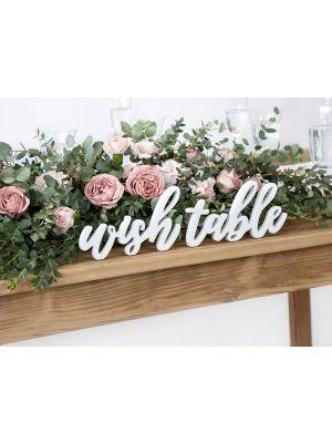 """Valkoinen puinen kyltti """"wish table""""."""