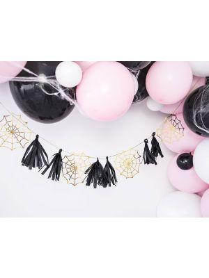 Halloween koristeviiri, mustia tasseleita ja kultaisia hämähäkin verkkoja.
