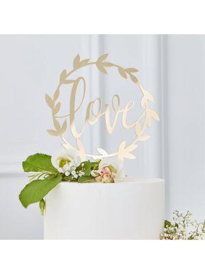 """Kultainen hääkakkukoriste, tekstillä """"love""""."""