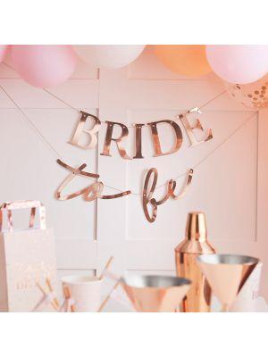 """Ruusukultainen polttaribanneri tekstillä """"BRIDE to be""""."""