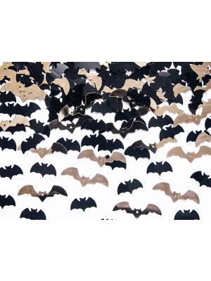 Mustat ja kultaiset lepakko konfetit halloween juhliin.