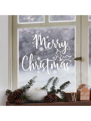 """Jouluiset valkoiset ikkunatarrat ja lumihiutaleet jossa lukee """"Merry Christmas""""."""