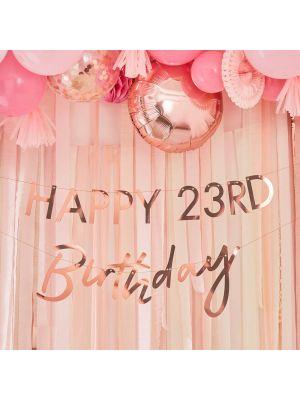 """Ruusukultainen banneri """"Happy Birthday"""" numerolla."""