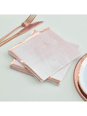 Vaaleanpunasävyiset lautasliinat joissa reunat on ruusukultafolioidut.