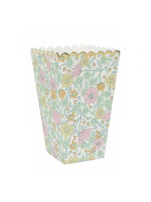 pienet valko-vaaleanpunaiset popcorn-kipot kultaisella reunalla