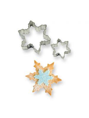 Iso ja pieni lumihiutale-muotti pikkuleipien, pipareiden tai koristeiden tekoon.