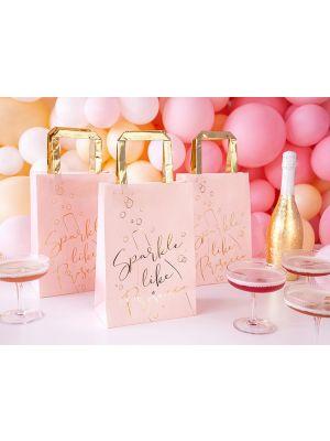 """Vaaleanpunaiset lahjakassit kultaisella tekstillä """"Sparkle like Prosecco""""."""