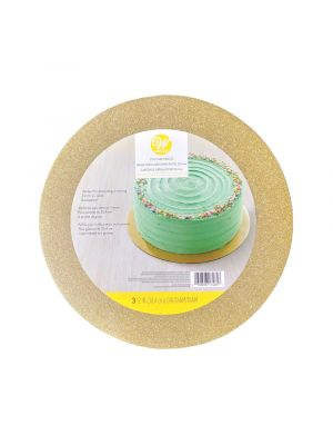 Kultaglitterillä koristettu Wiltonin kakkualusta. Kakkualusta on pyöreä ja halkaisijaltaan 30 cm.