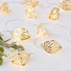LED valonauha kultaisilla lehdillä.