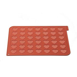 Silikomart:in kätevä alusta, jolla teet sydän-muotoisia macaronsia.