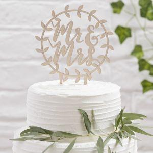 Puinen kakkukoriste jossa lukee Mr & Mrs.